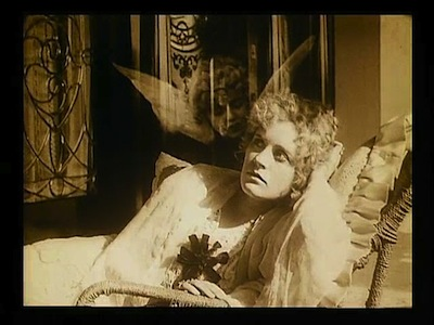 "Still from Lois Weber's ""Where Are My Children?"" depicting the soul of a baby above a possible mother..."